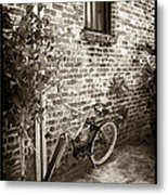 Bike In Pirates Alley Metal Print by John Rizzuto