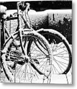 Bike Under Snow Metal Print