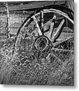 Black And White Photo Of An Old Broken Wheel Of A Farm Wagon Metal Print