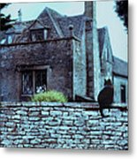 Black Cat On A Stone Wall By House Metal Print
