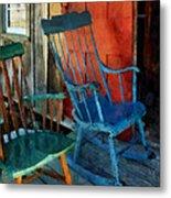 Blue Chair Against Red Door Metal Print