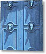 Blue Door Decorated With Wooden Animal Heads Metal Print