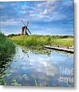 Blue Sky And Windmill Reflected In River Metal Print