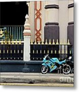Blue Yellow Sporty Motorcycle Parked On Pavement Metal Print