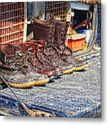 Boots Lined Up After The Hunt Metal Print