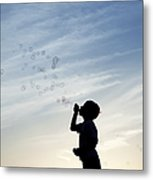 Boy Blowing Bubbles Metal Print by Tim Gainey