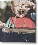 Boy Mesmerised By The Element Of Water In Motion Metal Print