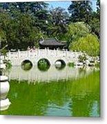 Bridge Over Emerald Water Metal Print
