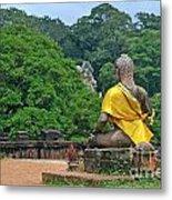 Buddha Statue Wearing A Yellow Sash Metal Print