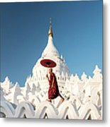 Buddhist Monk Walking Across Arches Of Metal Print