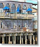 Building On Piles Above Water Metal Print by Lorna Maza
