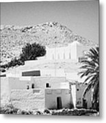 buildings and palm trees overground on the surface at Matmata Tunisia Metal Print