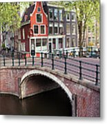 Canal Bridge And Houses In Amsterdam Metal Print