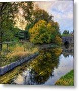 Canal Drifting Leaves Metal Print