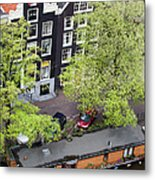 Canal Houses And Houseboat In Amsterdam Metal Print