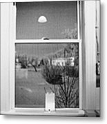 Candle In The Window Looking Out Over Snow Covered Scene In Small Rural Village Metal Print by Joe Fox