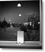 candle in the window looking out over snow covered scene in small rural village of Forget Saskatchew Metal Print