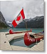 Canoes And Canada Flag At Lake Louise Metal Print