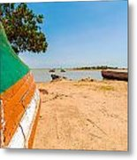 Canoes On A Lakeshore Metal Print