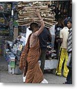 Carrying Cardboard Metal Print