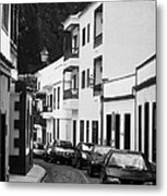 cars parked in a narrow tradtional cobble stone street in Garachico Tenerife Canary Islands Spain vertical Metal Print