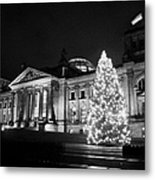 christmas tree and german flag flying fluttering on flagpole outside reichstag building Berlin Germany Metal Print