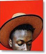 Close-up Of Man Wearing Hat Against Red Metal Print