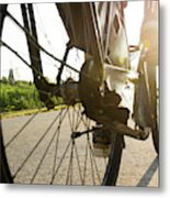 Close Up Of Wheel Of Bicycle On Road Metal Print