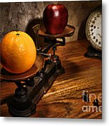 Comparing Apple And Orange Metal Print by Olivier Le Queinec