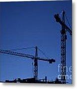 Construction Cranes At Dusk Metal Print