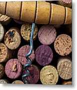 Corkscrew On Top Of Wine Corks Metal Print by Garry Gay