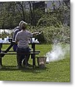 Couple Enjoying A Picnic In A Grassy Area Metal Print