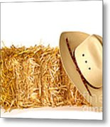 Cowboy Hat On Straw Bale Metal Print by Olivier Le Queinec
