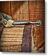 Cowboy Themed Wood Barrel And Spur Metal Print by Paul Ward