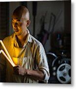 Craftsmen Holding A Lightning Bolt Shaped Neon Light Metal Print