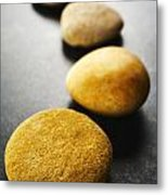 Curving Line Of Brown Pebbles On Dark Background Metal Print by Colin and Linda McKie