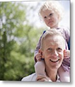 Daughter On Father's Shoulders, Holding His Ears Metal Print