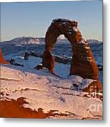 Delicate Arch With Snow At Sunset Arches National Park Utah Metal Print