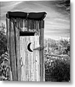 Desert Outhouse Under Stormy Skies Metal Print