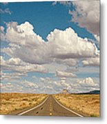 Desert Road With Cloud Formations Above Metal Print
