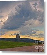 Devils Tower On The Horizon At Sunset Metal Print