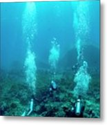 Divers Over A Coral Reef Metal Print