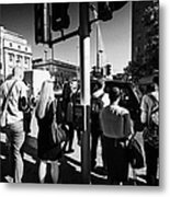 early morning commuters waiting to cross the road pedestrian crossing London England UK Metal Print