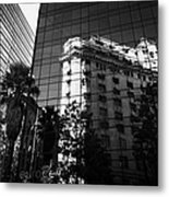 edificio ariztia building reflected in modern bank buildings in the financial district of Santiago Chile Metal Print