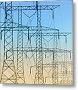 Electricity Pylons Standing In A Row Metal Print