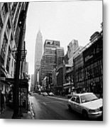 Empire State Building Shrouded In Mist As Yellow Cab Taxi New York City Metal Print by Joe Fox