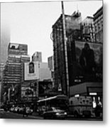 empire state building shrouded in mist from west 34th Street and 7th Avenue new york city usa Metal Print