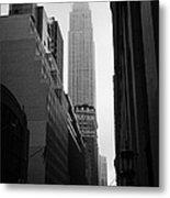 empire state building shrouded in mist in amongst dark cold buildings on 33rd Street new york city Metal Print by Joe Fox