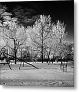empty childrens playground with hoar frost covered trees on street in small rural village of Forget  Metal Print