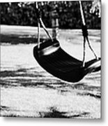 Empty Plastic Swing Swinging In A Garden In The Evening Metal Print